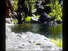 Nude at a river