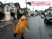 Naked Girl In A Weird Costume Runing On The Streets Video