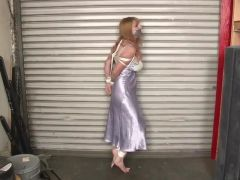 Tied in nightgown standing barefooted