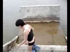 Russian amateur girl bathing nude in a river